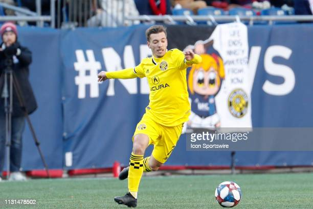 Columbus Crew midfielder Pedro Santos latches onto the ball during a match between the New England Revolution and Columbus Crew SC on March 9 at...