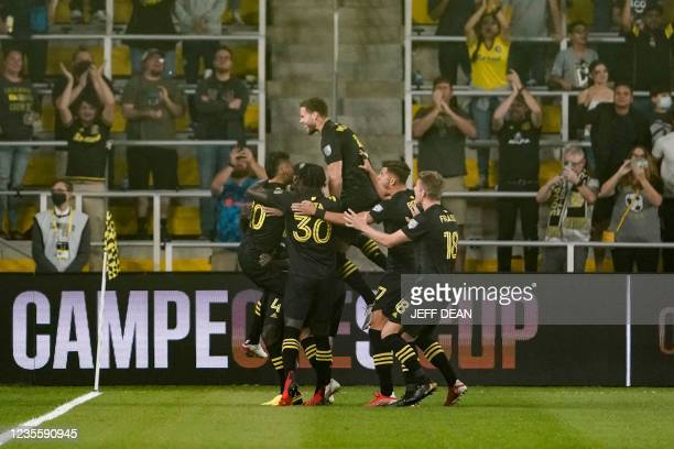 Columbus Crew players celebrate Brayan Angulo's goal during the first half of a Campeones Cup soccer match against Columbus Crew at Lower.com Field...