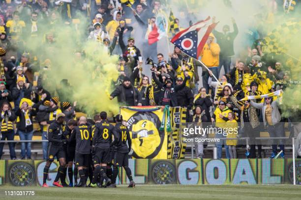 Columbus Crew SC defender Gaston Sauro celebrates with teammates after scoring a goal in the MLS regular season game between the Columbus Crew SC and...