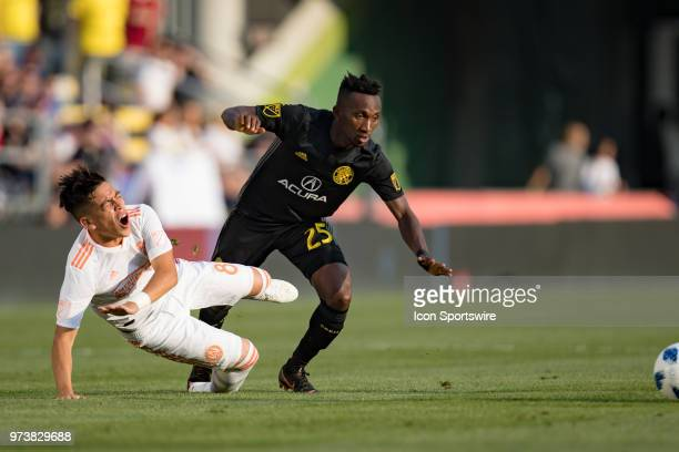 Columbus Crew SC defender Harrison Afful and Atlanta United FC midfielder Ezequiel Barco collide in the MLS regular season game between the Columbus...