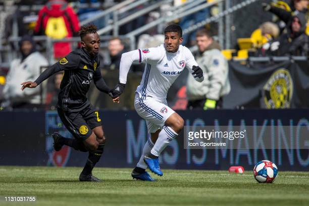 Columbus Crew SC defender Harrison Afful and FC Dallas midfielder Bryan Acosta battle in the MLS regular season game between the Columbus Crew SC and...