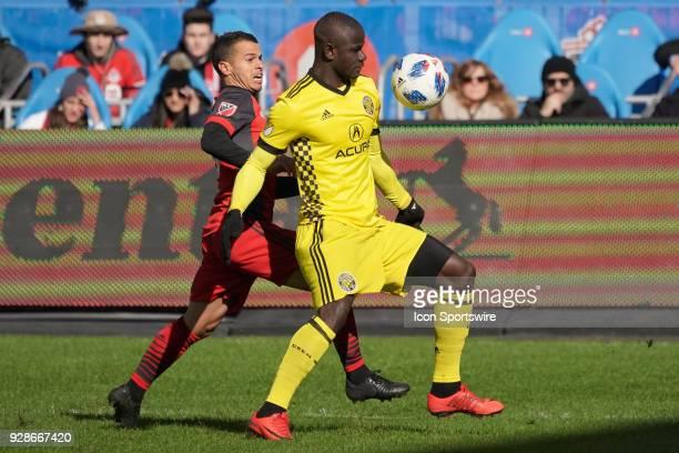 Columbus Crew SC Defender Jonathan Mensah keeps Toronto FC Forward Sebastian Giovinco at bay as he handles the ball during the MLS regular season...