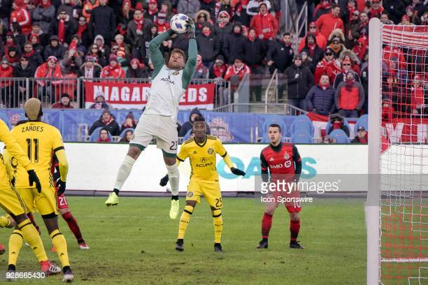 Columbus Crew SC Goalkeeper Zack Steffen jumps to catch the ball as Columbus Crew SC Defender Harrison Afful and Toronto FC Forward Sebastian...