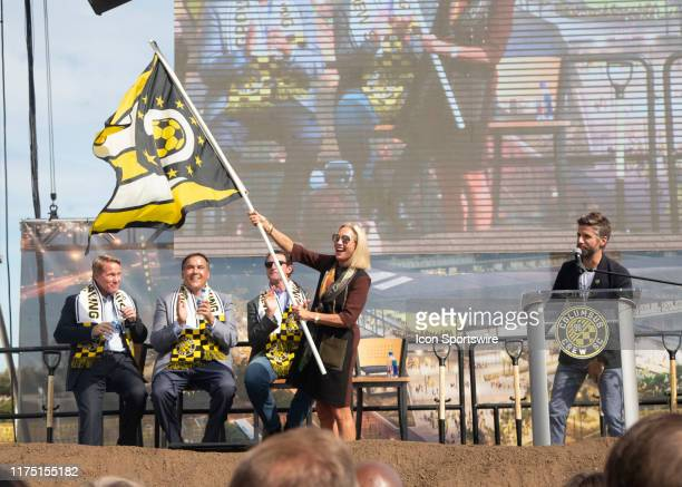 Columbus Crew SC Investor Operator Dee Haslam waving a custom Columbus Crew SC Ohio State flag during the groundbreaking ceremony of the new Columbus...