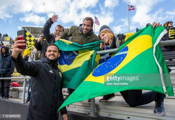 Columbus Crew SC midfielder Artur takes a selfie with fans from Brazil after winning the MLS regular season game between the Columbus Crew SC and the...