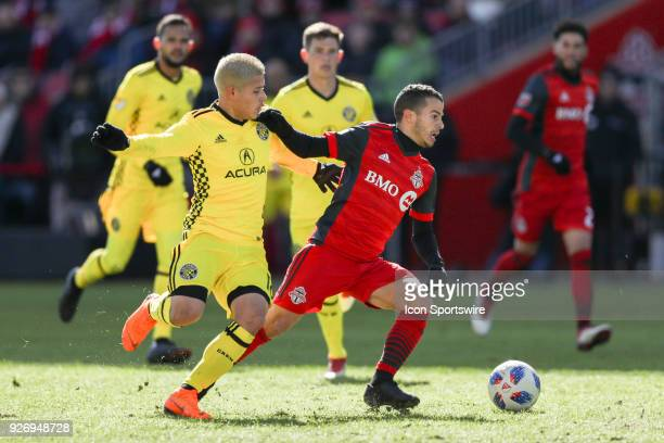 Columbus Crew SC Midfielder Cristian Martinez chases Toronto FC Forward Sebastian Giovinco during the MLS regular season Toronto FC homeopener played...