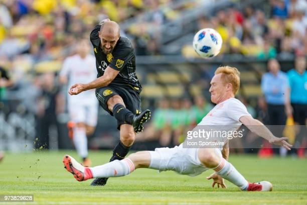 Columbus Crew SC midfielder Federico Higuain takes a shot on goal as Atlanta United FC midfielder Miguel Almiron defends in the MLS regular season...