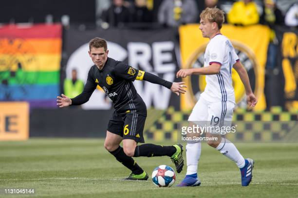 Columbus Crew SC midfielder Will Trapp defends as FC Dallas midfielder Paxton Pomykal passes the ball in the MLS regular season game between the...