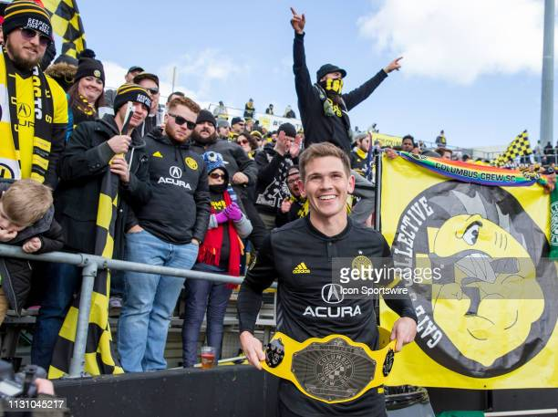 Columbus Crew SC midfielder Will Trapp poses with a Nordecke Championship belt after winning the MLS regular season game between the Columbus Crew SC...
