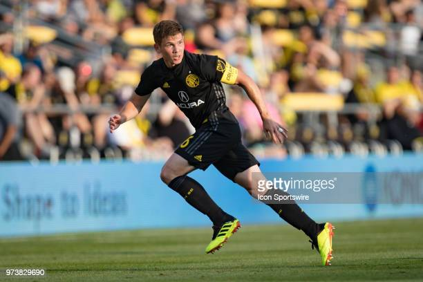 Columbus Crew SC midfielder Will Trapp watches for a defender as he sprints for the ball in the MLS regular season game between the Columbus Crew SC...