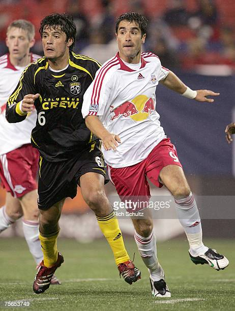 Columbus Crew's Marcos Gonzalez battles New York Red Bulls Juan Pablo Angel for position during the second half in an MLS game at Giants Stadium in...