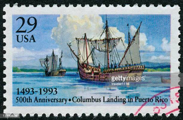 columbus landing in puerto rico stamp - colonialism stock photos and pictures