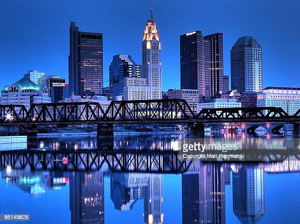 columbus, oh skyline reflected - columbus ohio stock pictures, royalty-free photos & images