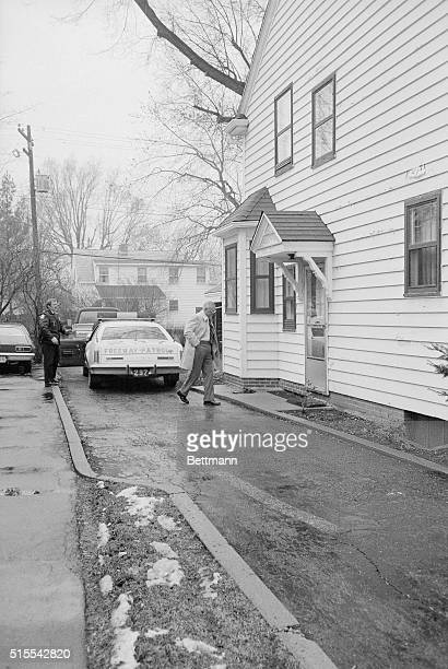 Ohio State football coach Woody Hayes walks alone from the police car that brought him to his home following his arrival in Columbus with the OSU...