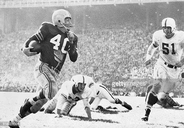"Columbus, Ohio: Ohio State's Howard ""Hopalong"" Cassady streaks 46 yards to Indiana's two yard line as center Joe Amstutz closes in during the second..."