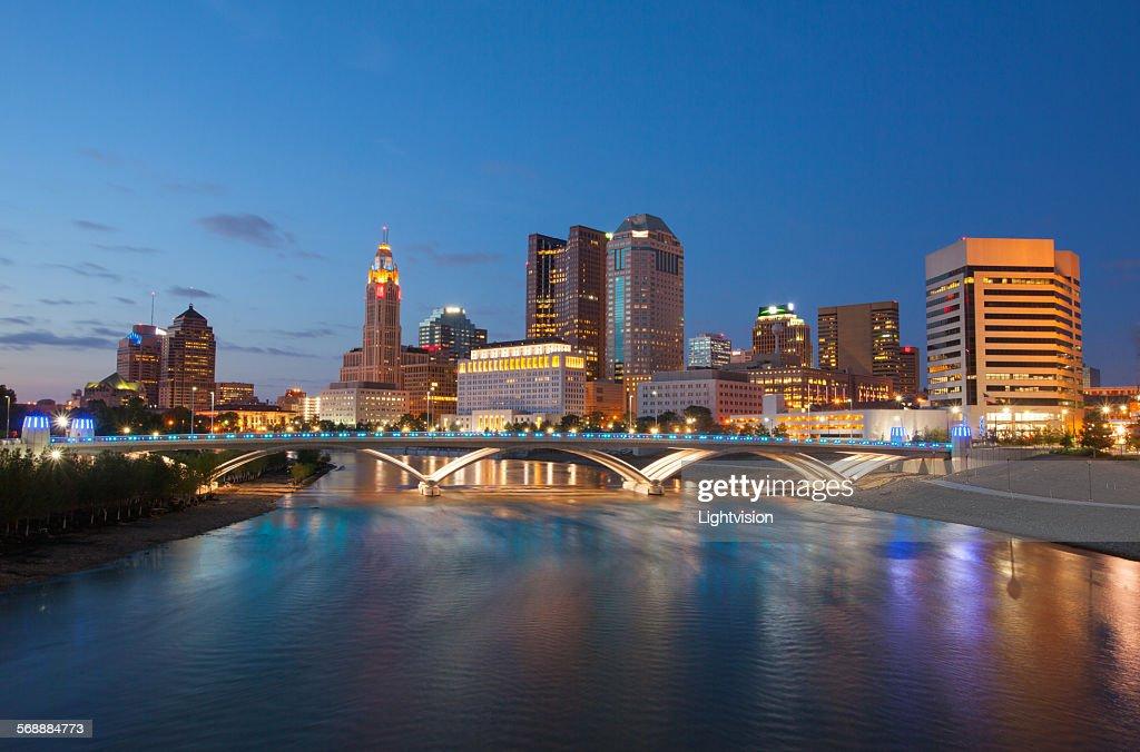 Columbus, Ohio skyline and Scioto River at night. : Stock Photo