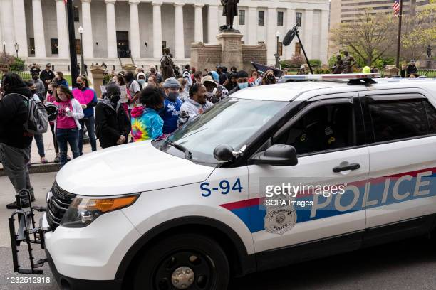 Columbus Police cruisers round the Ohio Statehouse interact with Black Lives Matter activists during the demonstration. Black Lives Matter activists...