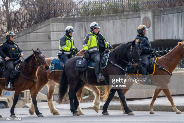 Columbus Police offers patrol the streets as members of Antifa march from City Hall to the Ohio Statehouse after President Joe Biden was sworn into...