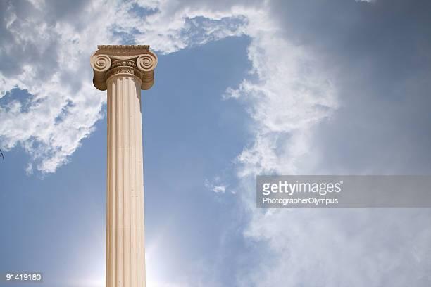 Column against cloudy sky