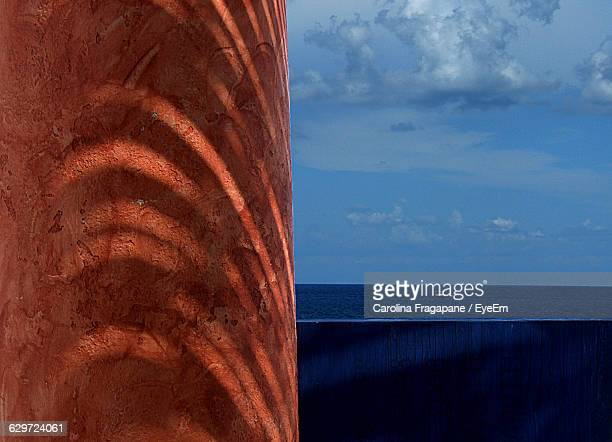 column by sea against sky - carolina fragapane stock pictures, royalty-free photos & images