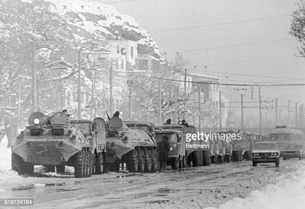 Column of armored vehicles and trucks of the Soviet army arrives at this snowbound city January 30 to reinforce the Russian military organization in...