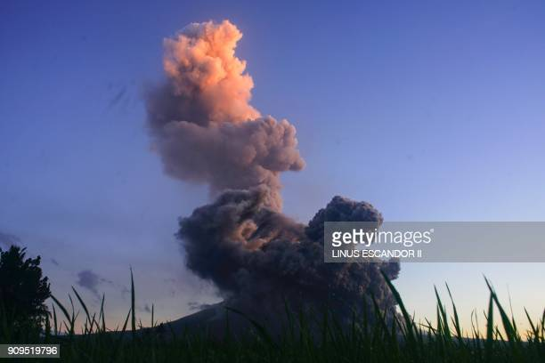 TOPSHOT A column of ash shoots up from the Mayon volcano as it continues to erupt seen from the town of Daraga in Albay province south of Manila on...