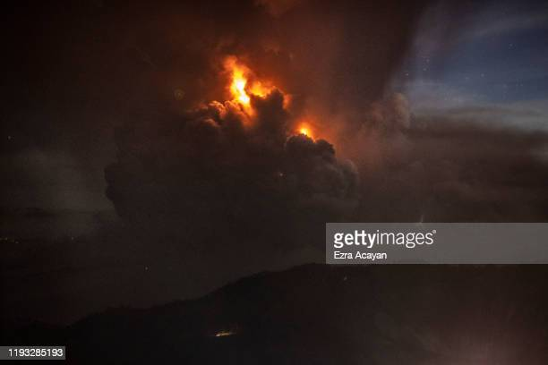 A column of ash surrounds the crater of Taal Volcano as it erupts on January 12 2020 as seen from Tagaytay city Cavite province Philippines Local...
