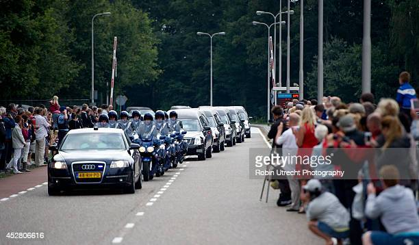 A column of hearses carry the bodies of victims from flight MH17 from Eindhoven airbase to Hilversum on July 25 in Eidhoven Netherlands This is the...