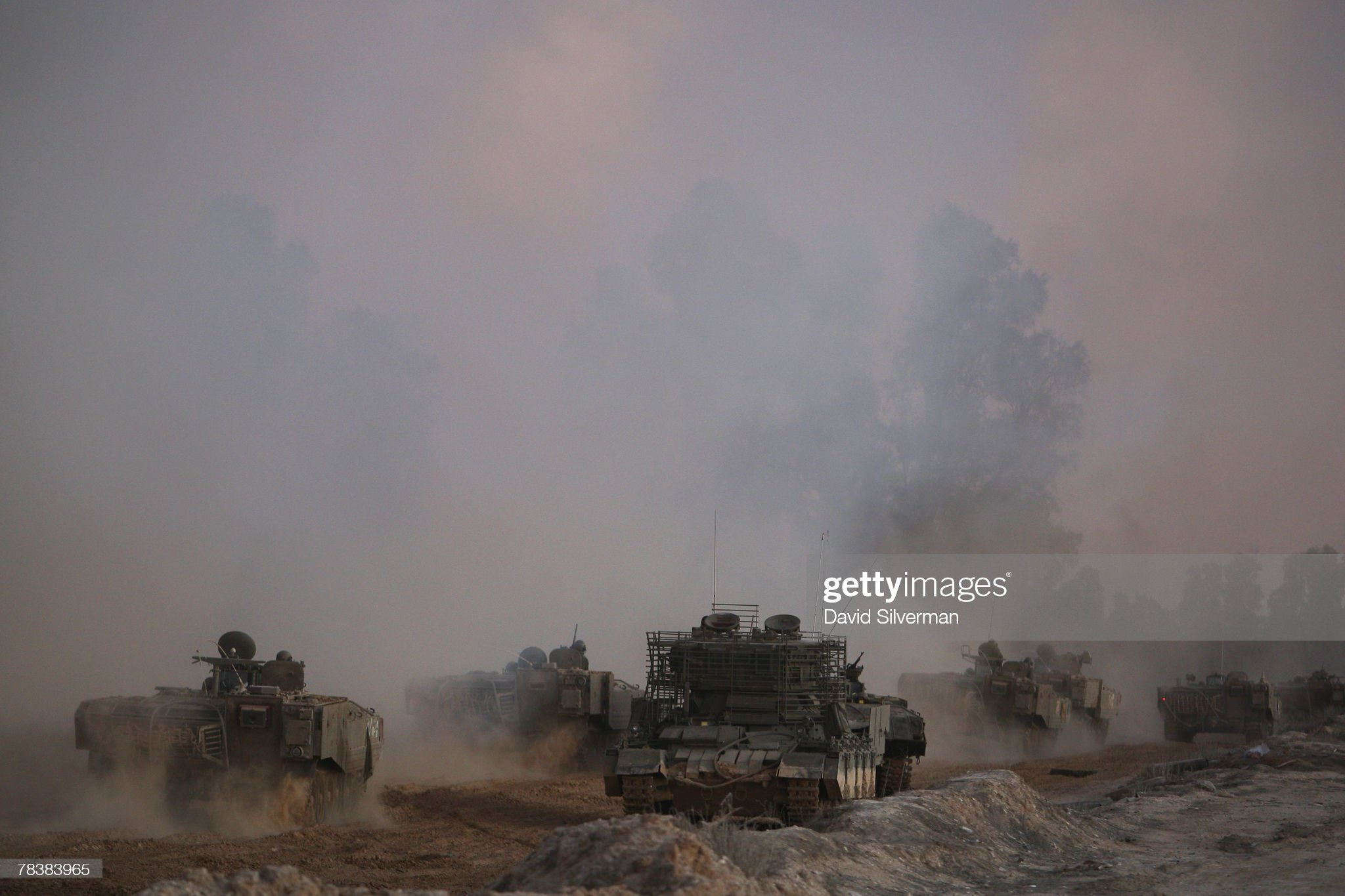 https://media.gettyimages.com/photos/column-of-israeli-armor-churns-up-dust-and-smoke-as-it-heads-for-base-picture-id78383965?s=2048x2048