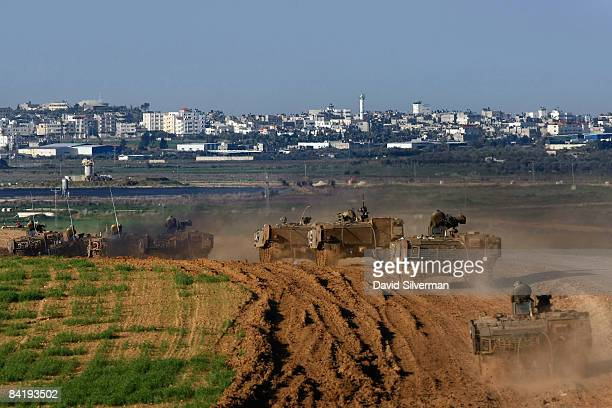 A column of Israeli armor heads to join the fighting against Hamas militants January 7 2009 as they advance on Israel's border with the Palestinian...
