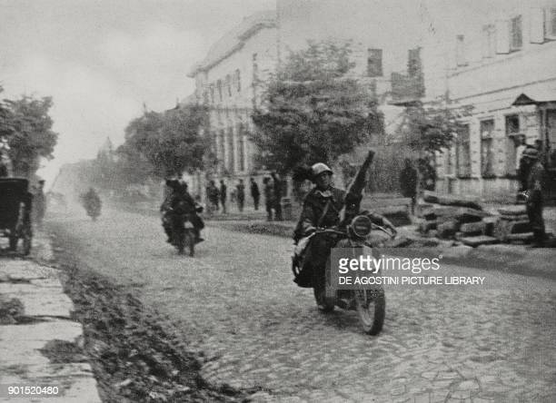 A column of motorcycle riflemen in the streets of a city Russia Eastern Front World War II from L'Illustrazione Italiana Year LXVIII No 33 August 17...