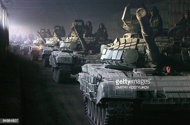 A column of Russian armoured vehicles moves towards the Roki tunnel on the border with Russia as they leave South Ossetia on August 23 2008 Russian...