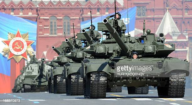 A column of Russia's T90 tanks rolls at the Red Square in Moscow on May 9 during Victory Day parade Fighter jets screamed over Red Square and heavy...