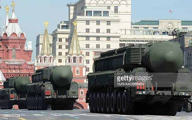 Column of Russia's Topol intercontinental ballistic missile launchers rolls at the Red Square in Moscow, on May 9 during Victory Day parade. Fighter...