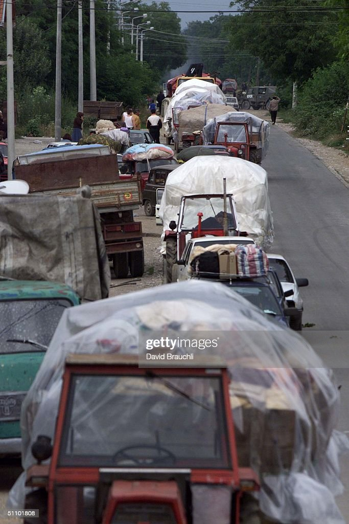 Column Of Serb Vehicles Wait To Leave Kosovo To Montenegro Friday June 25 1999 As Thousands Of E : News Photo