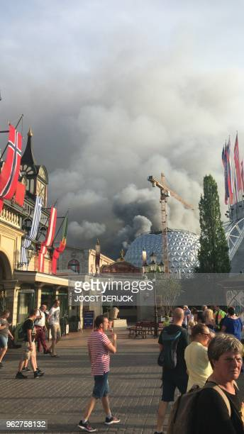 A column of smoke rises from a warehouse in flames above the amusement park 'Europapark' in Rust southern Germany on May 26 2018 A fire has broken...