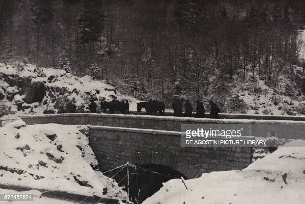 Column of soldiers crossing a bridge Italy World War I from l'Illustrazione Italiana Year XLV No 1 January 6 1918