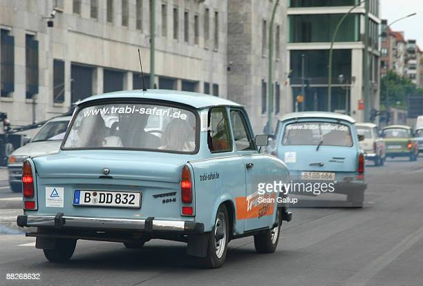 A column of Trabant cars ferry tourists on June 6 2009 in Berlin Germany Trabants were one of the main popular symbols of the former communist East...