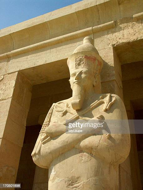 Column Statue Of Pharaoh Holding The Crook And Flail Symbols Of Power Over Upper And Lower Egypt At The Mortuary Temple Of Hatshepsut At Deir El...