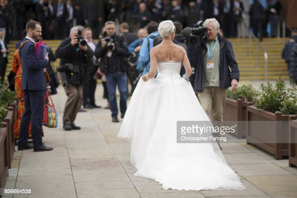 Columnist Katie Hopkins wears a wedding dress to promote a fringe event on day two of the Conservative Party Conference at Manchester Central on...