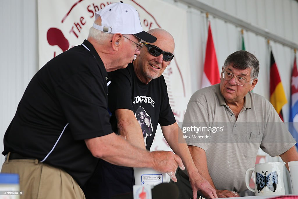 Columnist Nigel Collins (Center) inserts his fist into a bucket during the International Boxing Hall of Fame induction Weekend of Champions events on June 12, 2015 in Canastota, New York. Each inductee places his hand into the putty to cast a mold of their actual fist for preservation.