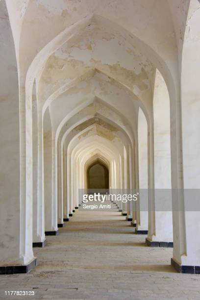 columns in poi-kalyan complex inner courtyard in bukhara - arch stock pictures, royalty-free photos & images