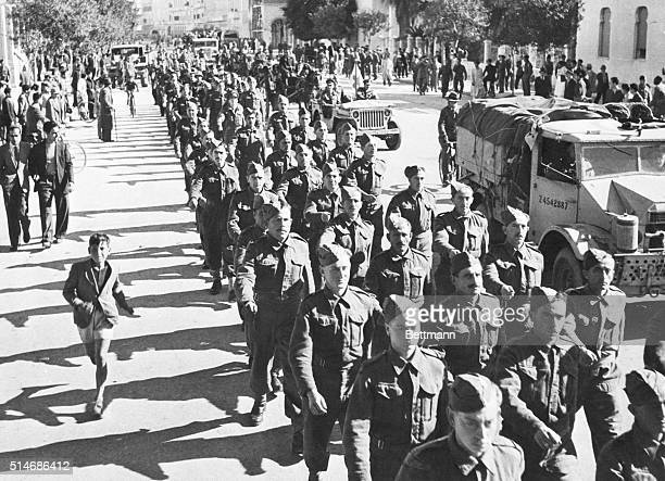 Columns of Jewish troops a part of the British Fifth Army parade through Tripoli shortly after Marshal Rommel and his Afrika Korps were driven from...