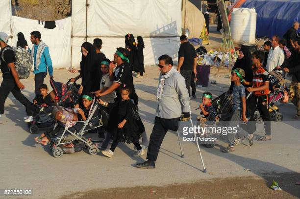 Columns of Shiite pilgrims including babies in strollers and a man with one leg march 50 miles from Najaf north to the shrine of Imam Hossein to...