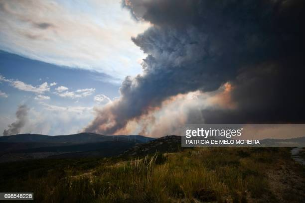 Columns of smoke rise from a wildfire in Gois Coimbra district on June 20 2017 The huge forest fire that erupted on June 17 2017 in central Portugal...