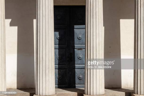 Columns of the pronaos and portal of one of the two Neoclassical buildings that form the Barriera Albertina ancient western gate to the city of...