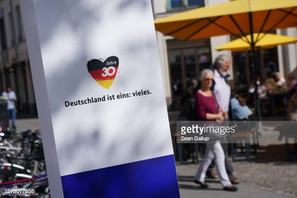 """Columns with the German flag and the slogan: """"Germany is one thing: much"""" mark the path of an outdoor exhibition that accompanies the upcoming 30th..."""
