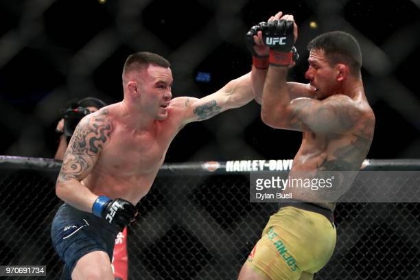 Coly Covington punches Rafael Dos Anjos of Brazil in the fifth round during their welterweight title fight during the UFC 225 Whittaker v Romero 2...