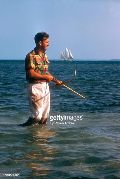 Colyn Rees uses his bow and arrow as he hunts for fish on April 7 1956 in the Bahamas