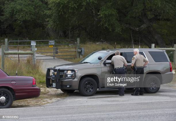 Comal County Sheriff deputies at the front gate to the home and property of Devin P Kelley November 6 2017 near New Braunfels Texas Kelley was the...